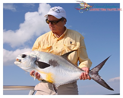 Edward Johnston with a fine Turneffe permit : Turneffe Island Lodge