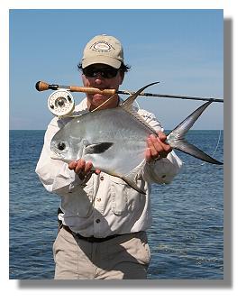 Edward Johnston holding a permit fish at Casa Redonda Suites