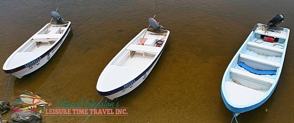 Panga skiffs at Tarpon Cay Lodge