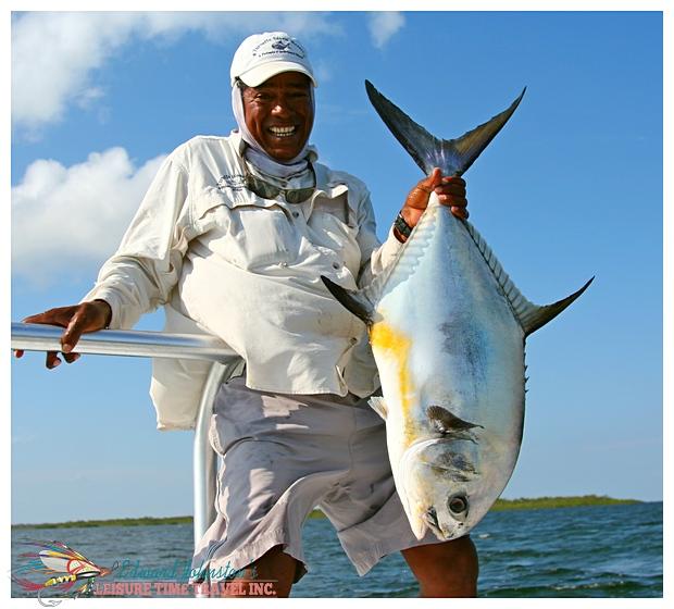 Turneffe Island Resort : Tacu Johnston with a very fine Turneffe Island permit, Flats Fishing Turneffe Island